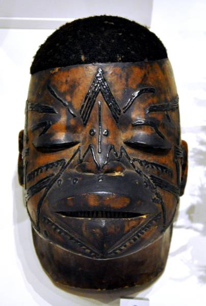 Mask with scarification marks from the Makonde people in Mozambique.